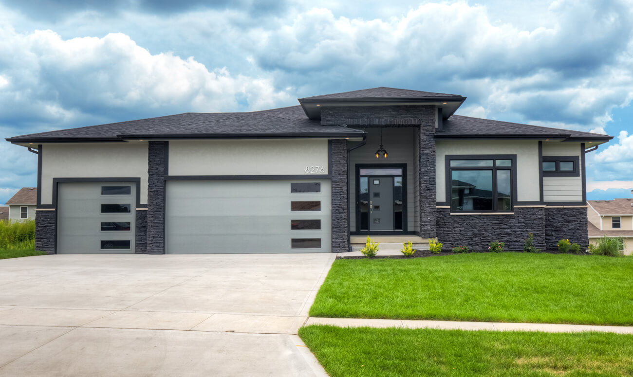 One-story, grey, modern-style home built by Kruse Development.