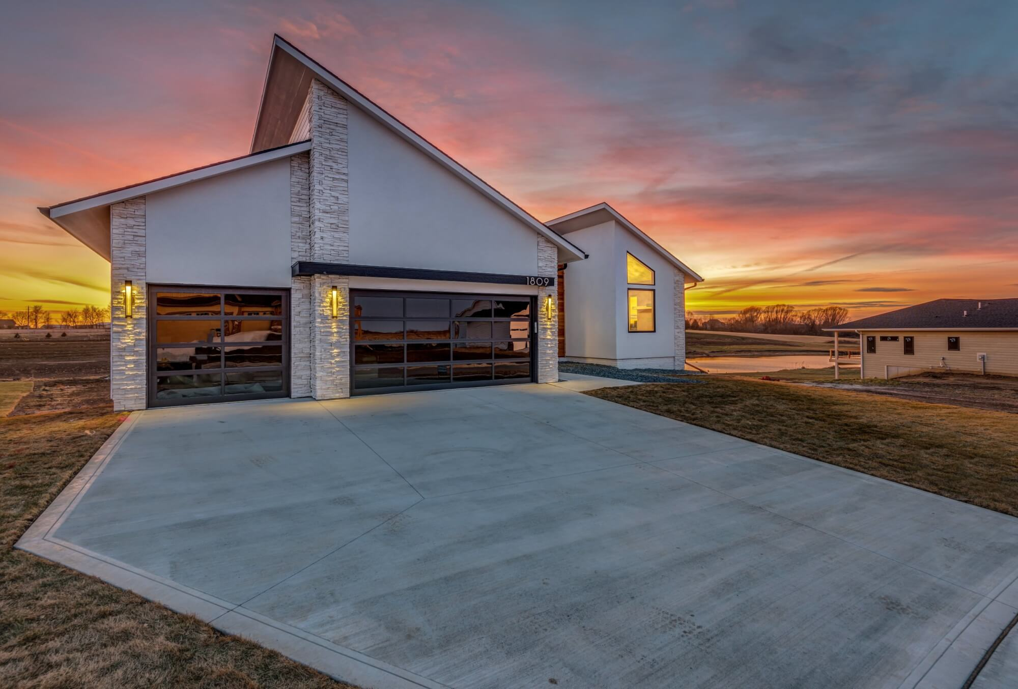 Modern, geometric home built by Kruse Development with the sunset in the background.