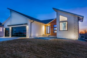 A stone and wood home with an angled roof, built by Kruse Development.