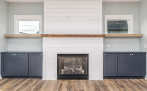 A picture of a black and white fireplace built by Kruse Development.