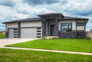 A grey house with dark grey stone, built by Kruse Development.