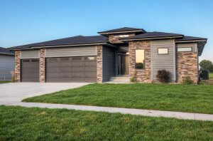 A brown brick and grey siding home built by Kruse Development.