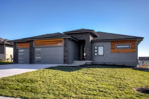 A stone and wooden exterior of a home built by Kruse Development.