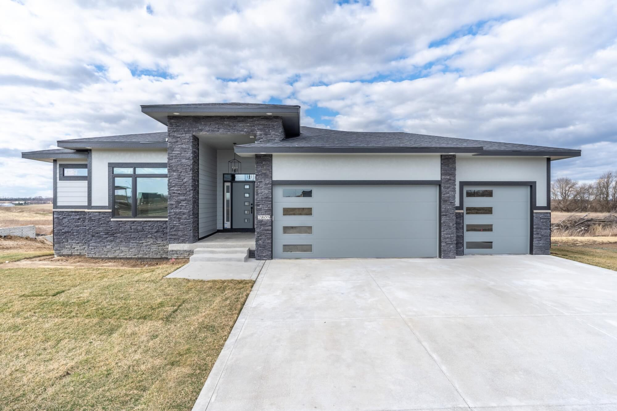 A one-story, grey-colored home built by Kruse Development in Central Iowa.