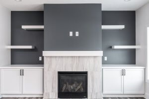 A white and grey fireplace built by Kruse Development.
