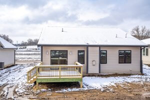 A picture of a house with a newly-built deck from Kruse Development.