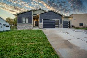A dark grey and light grey house built by Kruse Development.
