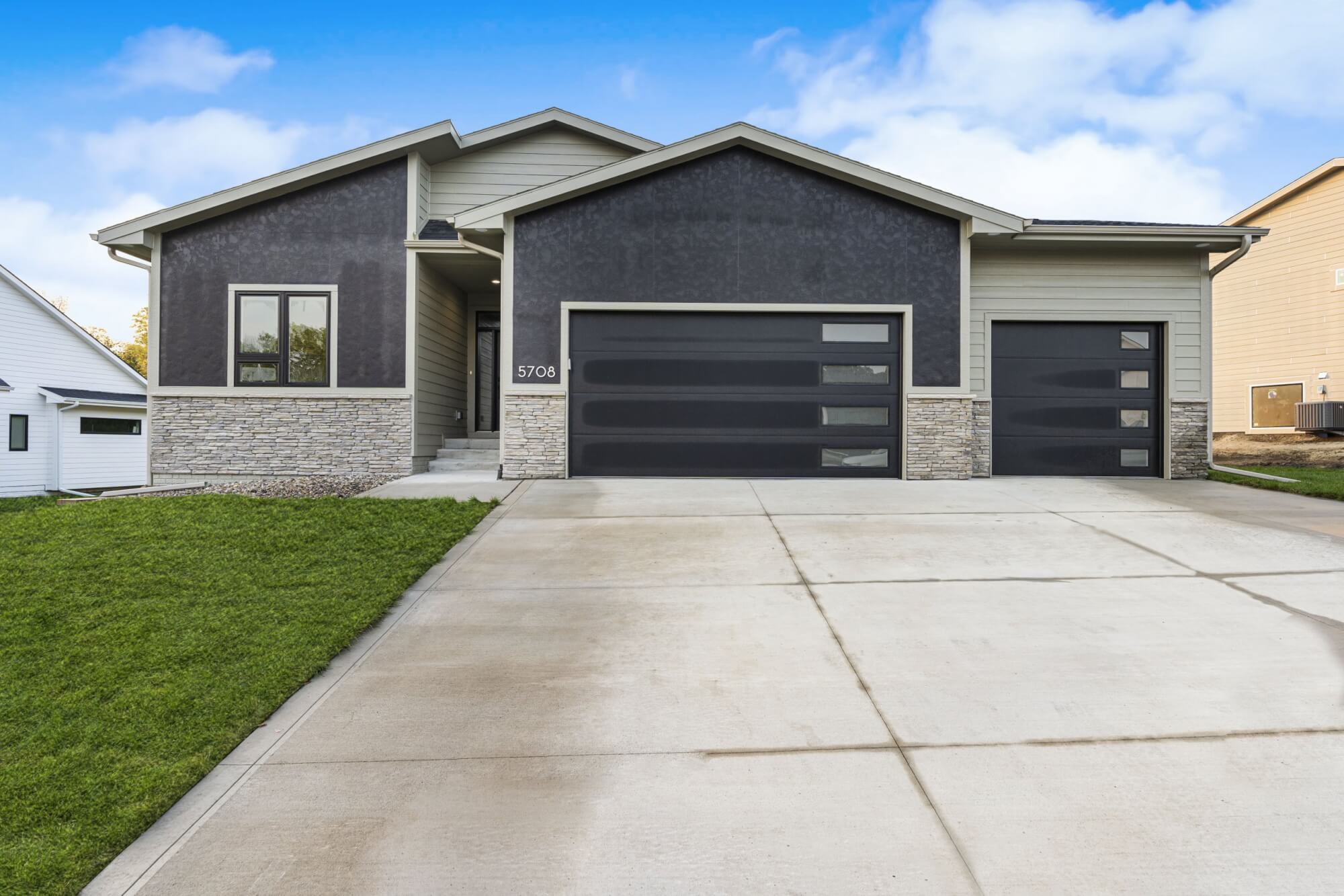 A black and grey home built by Kruse Development.