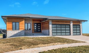 Wood and grey stone home built by Kruse Development.